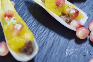 Chicory leaf with Thai beef, mango and pomegranate salsa