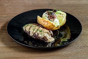 Main Course - Roast beef tenderloin, mushroom sauce with stuffed baked potato