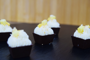 Sweet - Chocolate cup filled with pineapple coconut mousse